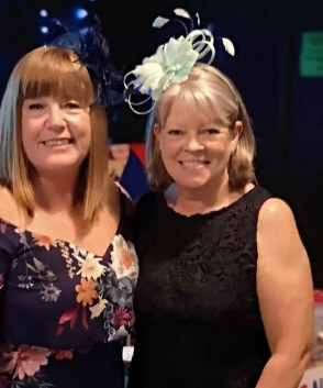 College Charity Race Night Event Organisers Joanne and Julie standing next to each other at the MIND event