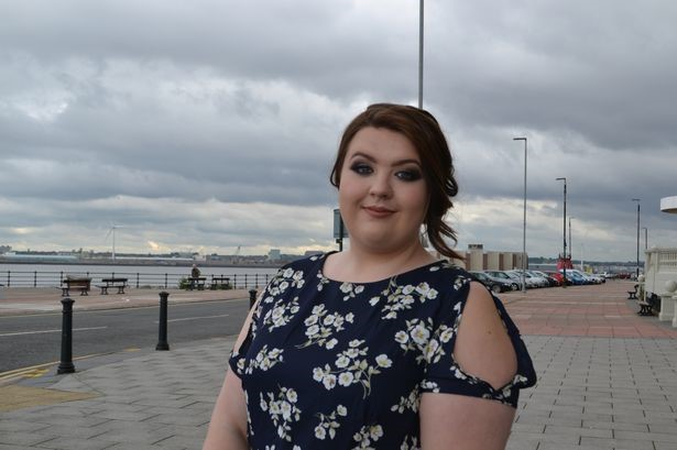 Former Wirral Met Health and Social Care student Alisha Nelson standing near the Floral Pavillion