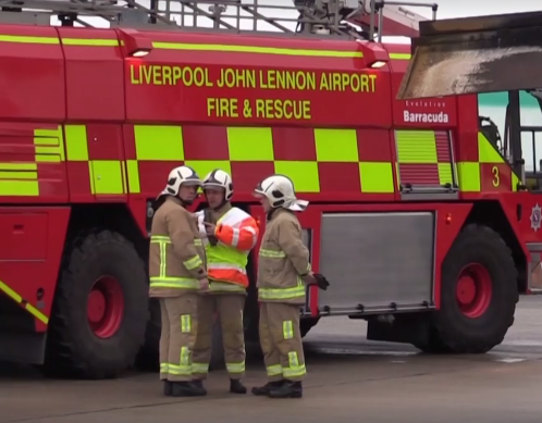 Fire Engine and Firefighters at Liverpool John Lennon Airport for Wirral Met College Travel and Tourism Live Emergency Exercise