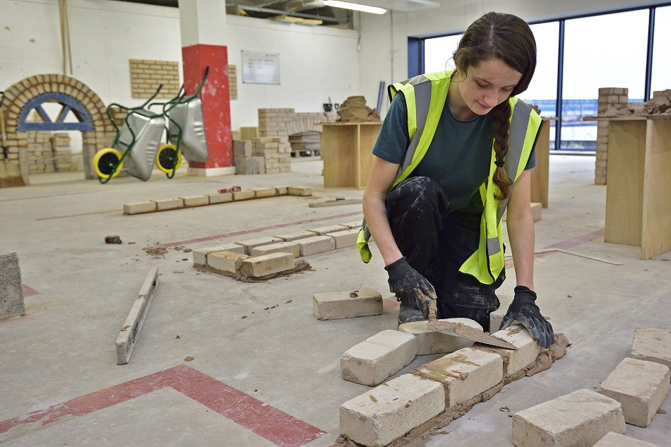 Female Wirral Met Bricklaying Student  working in a classroom at Wirral Waters Campus