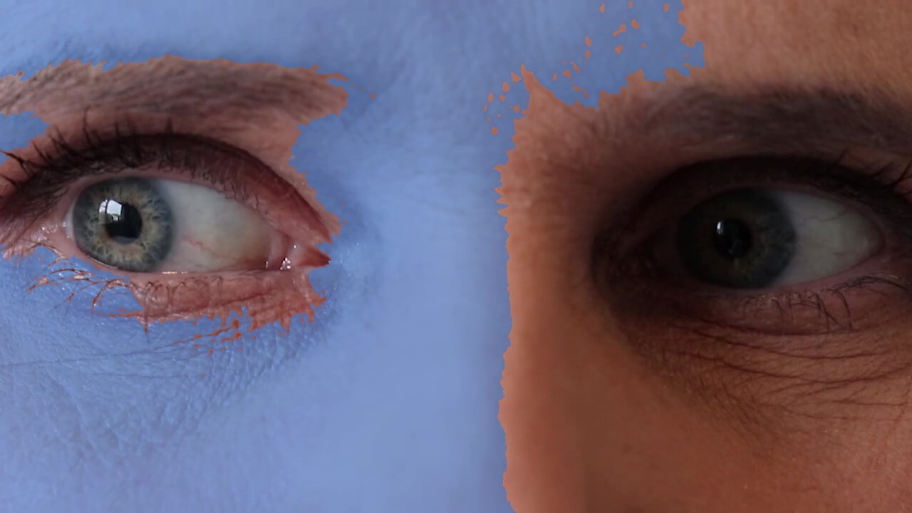Close up of eyes with the left hand side covered in blue