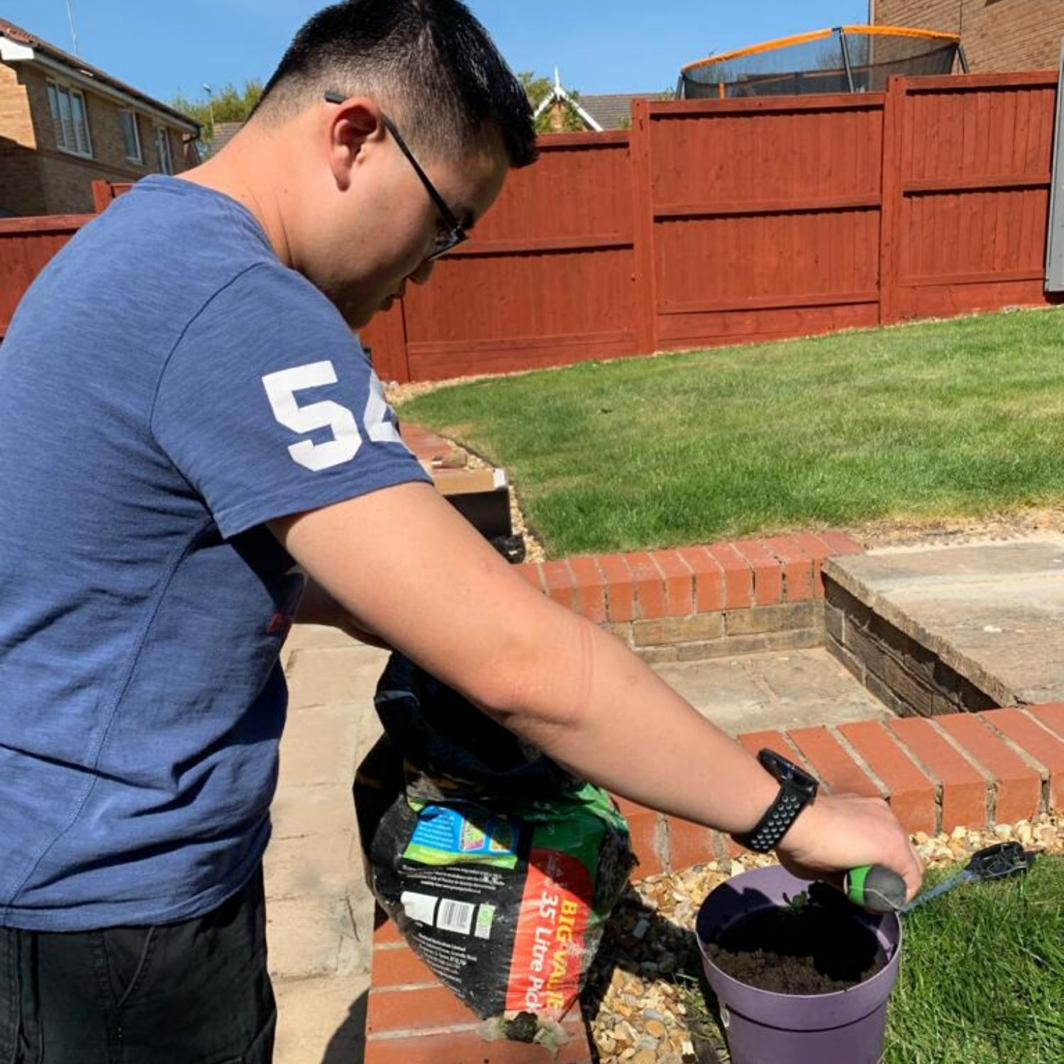 Prep 4 Life Student Calvin Planting a Sunflower in His Garden