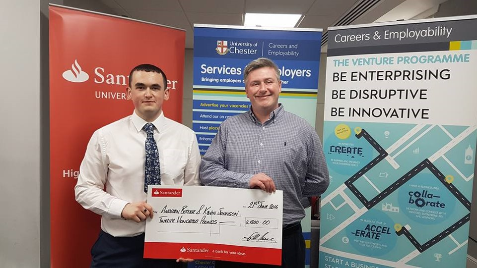 Kevin Johnson and Andrew Butler with large bank cheque