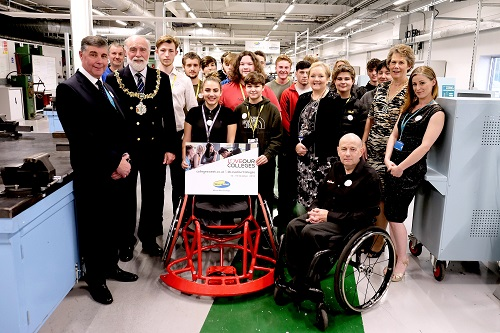 Mayor and Mayoress standing next to Wirral Met Stem Students