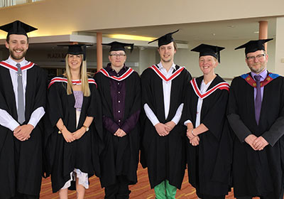 Wirral Met Access To HE Students Standing Together For Graduation