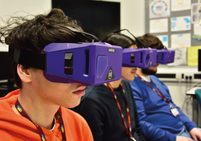 Three CPD Computing And IT Students Wearing Virtual Reality Headsets In Classroom
