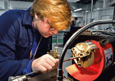 Male University Level Engineering Student Working In Workshop