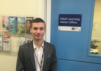 Male Skills For Life And Work CPD Student Standing Outside Adult Learning Admin Office