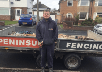 Wirral Met Supported Intern standing outside of a Peninsula Fencing g outside