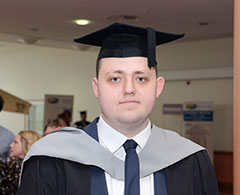 Science Full Time Case Study Adam Ravenscroft Wearing Graduation Outfit