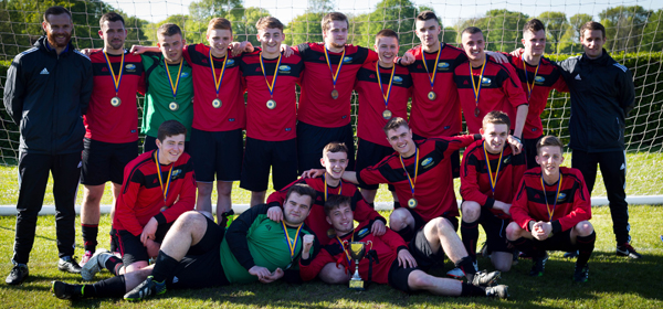 elebrates being this year's Merseyside Cup Winners!